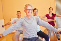 Smiling senior in back training. Class with dumbbells in fitness center Royalty Free Stock Images