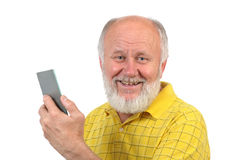 Smiling senior bald man with mirror Stock Images
