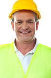 Smiling senior builder wearing hardhat Royalty Free Stock Photography