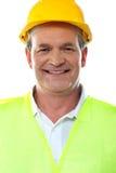 Smiling senior builder wearing hardhat Royalty Free Stock Photography