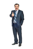 Smiling senior business man gives thumbs Royalty Free Stock Image