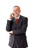 Smiling senior business man, phoning Royalty Free Stock Photo