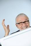 Smiling senior businessman. Vertical image of happy senior businessman Royalty Free Stock Images