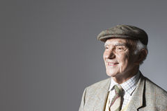 Smiling Senior Businessman In Flat Cap Royalty Free Stock Photos