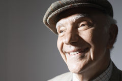 Smiling Senior Businessman In Flat Cap Stock Photos