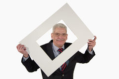 Smiling senior businessman holding a photo mount Stock Images