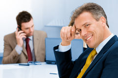 Smiling senior businessman in office Royalty Free Stock Photo