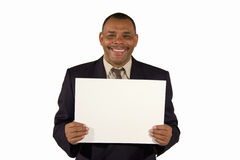 Smiling senior businessman presenting a board Stock Photo