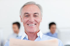 Smiling senior businessman reading Royalty Free Stock Photos
