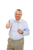 Smiling senior businessman showing thumb up Royalty Free Stock Photo