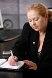 Senior businesswoman taking note Stock Photos