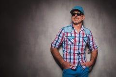 Smiling senior casual man wearing baseball hat looking away. To side in studio Royalty Free Stock Photos