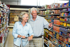 Smiling senior couple buying food Stock Image