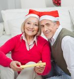 Smiling Senior Couple With Christmas Present Royalty Free Stock Photography