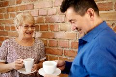 Smiling senior couple drink coffee or tea Royalty Free Stock Photography
