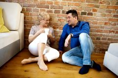 Smiling senior couple drink coffee or tea Stock Photography
