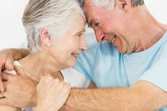 Smiling senior couple face to face Stock Photography