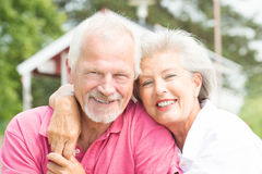 Smiling senior couple stock photography