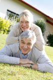 Smiling senior couple having fun outdoors Stock Photography