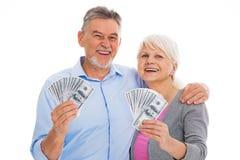 Smiling senior couple holding money Royalty Free Stock Photography