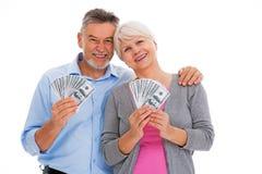 Smiling senior couple holding money Royalty Free Stock Image