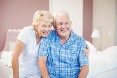 Smiling senior couple at home Stock Photo