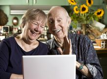 Smiling Senior Couple with a Laptop Computer Royalty Free Stock Photo