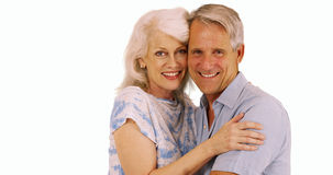 Smiling senior couple looking at camera on white background Royalty Free Stock Image
