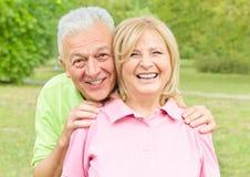 Smiling senior couple outdoors stock photo