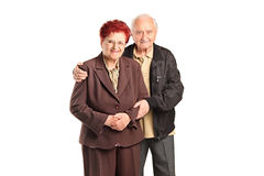 Smiling senior couple posing Stock Photography