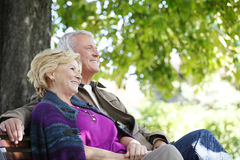 Smiling senior couple relaxing outdoor Stock Photo