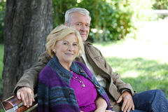 Smiling senior couple relaxing outdoor Stock Images