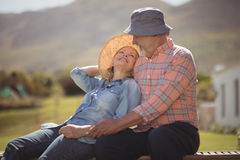 Smiling senior couple relaxing together on bench Royalty Free Stock Images