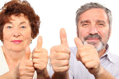 Smiling senior couple show thumb Stock Photography