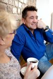 Smiling senior couple drink coffee or tea Stock Images