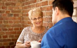 Smiling senior couple drink coffee or tea Royalty Free Stock Image