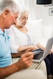 Smiling senior couple using laptop Royalty Free Stock Image