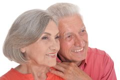 Smiling senior couple wearing bright clothing on white background. Smiling senior couple wearing bright clothing isolated on white background royalty free stock photos