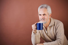 Smiling senior with a cup Stock Photos