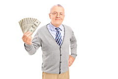 Smiling senior gentleman holding money Stock Photos