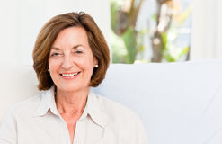 Smiling senior at home Stock Images