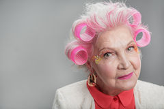 Smiling senior lady with extravagant makeup Stock Image