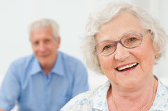 Smiling senior lady with husband Stock Photo