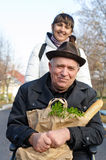 Smiling senior man with a bag of groceries Stock Image