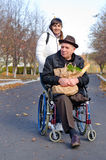 Smiling senior man with a bag of groceries royalty free stock photo