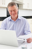 Smiling Senior Man Checking Finances On Laptop Royalty Free Stock Image