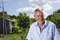 Smiling Senior Man In Community Garden Royalty Free Stock Images