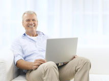 Smiling Senior Man On Couch Stock Photography
