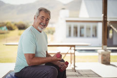 Smiling senior man exercising with dumbbells Royalty Free Stock Photography