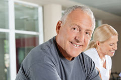 Smiling senior man in fitness. Portrait of a smiling senior men exercising in fitness center Stock Photos